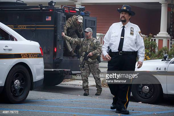 Pennsylvania State Police SWAT officers arrive at the Pike County Courthouse for Eric Frein's arraignment on October 31 2014 in Milford Pennsylvania...
