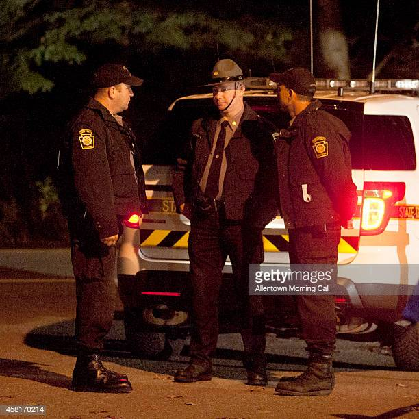 Pennsylvania State Troopers wait outside the Blooming Grove Township Building on Thursday Oct 30 hours after Eric Frein was apprehended at an...