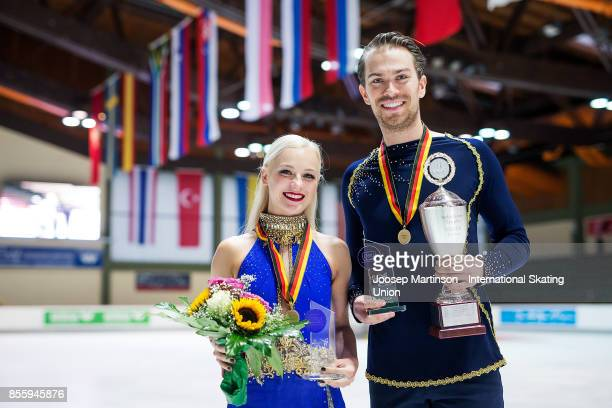 Penny Coomes and Nicholas Buckland of Great Britain pose in the Ice Dance medal ceremony during the Nebelhorn Trophy 2017 at Eissportzentrum on...