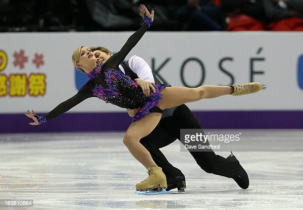 Penny Coomes and Nicholas Buckland of Great Britain skate in the Ice Dance Free Dance Program during the 2013 ISU World Figure Skating Championships...