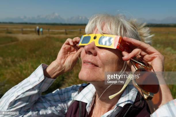 Penny FarsterNarlesky of Denver Colorado test her solar eclipse glasses at an roadside information center in Grand Teton National Park on August 20...