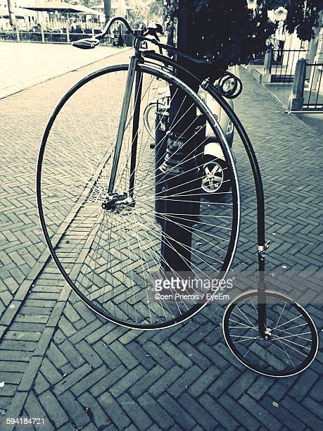 Penny Farthing Bicycle On Sidewalk