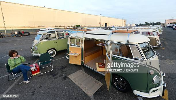 Penny Hansen gets comfortable beside her 1966 VW kombi at 'Das OCTO Fest 2013' a swap and display gathering for enthusiasts and owners of 1967 and...