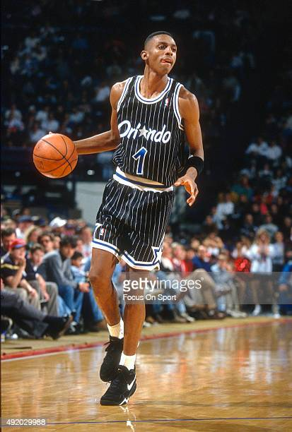 Penny Hardaway of the Orlando Magic dribbles the ball against the Washington Bullets during an NBA basketball game circa 1993 at US Airways Arena in...
