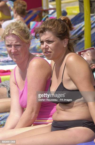 Penny Higgins 34 and Tessa Crews from Malvern in Worcestershire on the beach at Benalmadena on the Costa Del Sol in Spain despite a series of bomb...