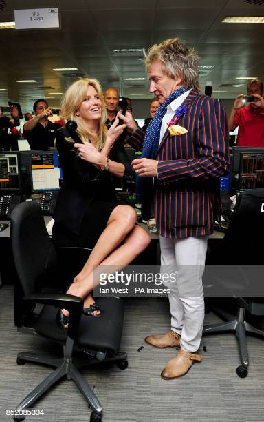 Penny Lancaster and Rod Stewart on the trading floor during the BGC Partners Charity Day in London's Docklands