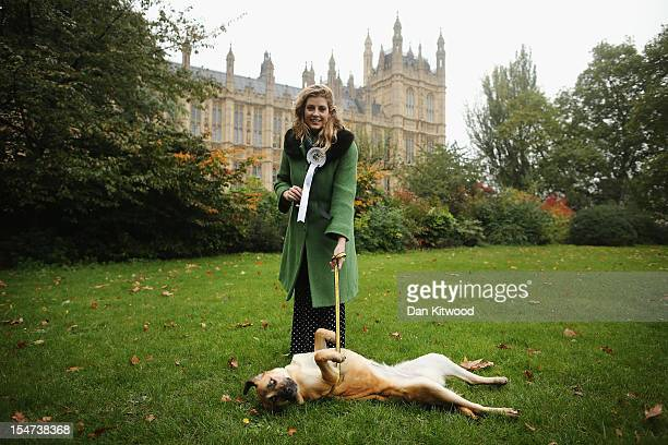 Penny Mordaunt Liberal Democrat MP for Cheltenham stands in front of The Houses of Parliament with her Labrador Cross Penny Lane during the...