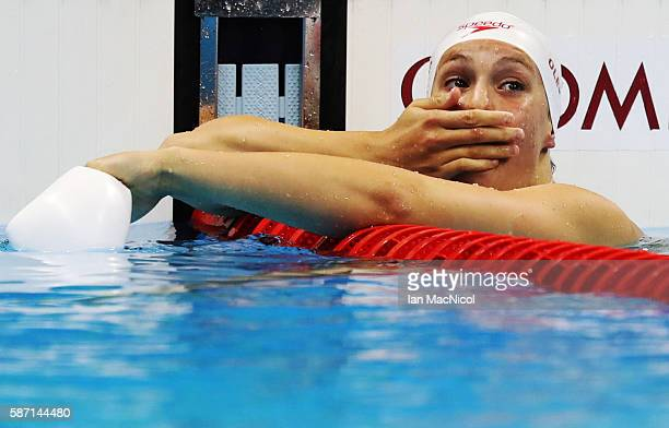 Penny Oleksiak of Canada celebrates after she wins silver in the Women's 100m Butterfly final during Day 2 of the Rio 2016 Olympic Games at Olympic...