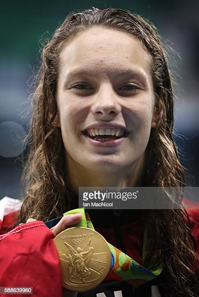 Penny Oleksiak of Canada poses with her Gold medal from the Women's 100m Freesyle on Day 6 of the Rio 2016 Olympic Games at the Olympic Aquatics...