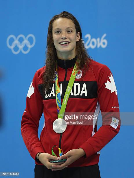 Penny Oleksiak of Canada poses with her silver imedal from the Women's 100m Butterfly final during Day 2 of the Rio 2016 Olympic Games at Olympic...