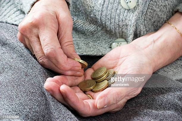 Penny pincher counting coins to save