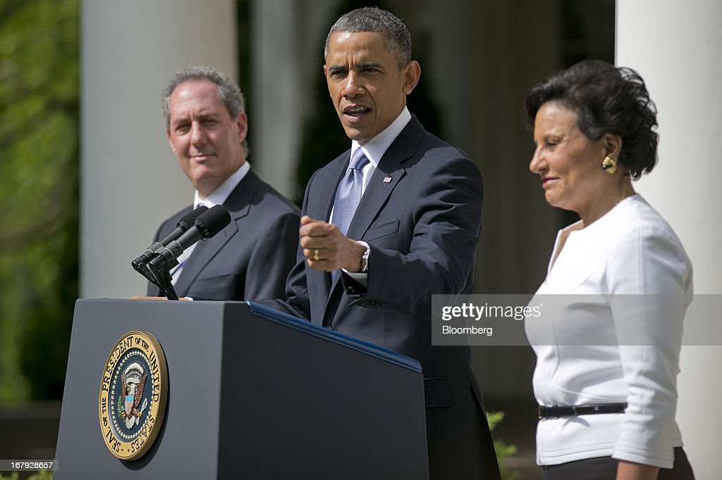 Penny Pritzker, chairman, president and chief executive officer of Pritzker Realty Group LLC and U.S. President <a gi-track='captionPersonalityLinkClicked' href=/galleries/search?phrase=Barack+Obama&family=editorial&specificpeople=203260 ng-click='$event.stopPropagation()'>Barack Obama</a>'s nominee as secretary of commerce, right, and Michael Froman, deputy national security adviser for international economics and U.S. President <a gi-track='captionPersonalityLinkClicked' href=/galleries/search?phrase=Barack+Obama&family=editorial&specificpeople=203260 ng-click='$event.stopPropagation()'>Barack Obama</a>'s nominee as U.S. trade representative, left, listen as U.S. President <a gi-track='captionPersonalityLinkClicked' href=/galleries/search?phrase=Barack+Obama&family=editorial&specificpeople=203260 ng-click='$event.stopPropagation()'>Barack Obama</a> makes an announcement in the Rose Garden of the White House in Washington, D.C., U.S., on Thursday, May 2, 2013. In nominating Pritzker, the Chicago billionaire and Hyatt Hotels Corp. heiress, Obama is choosing someone who potentially will face aggressive questioning from Republicans during confirmation hearings because of her complex financial portfolio. Photographer: Andrew Harrer/Bloomberg via Getty Images