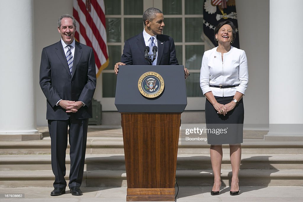Penny Pritzker, chairman, president and chief executive officer of Pritzker Realty Group LLC and U.S. President <a gi-track='captionPersonalityLinkClicked' href=/galleries/search?phrase=Barack+Obama&family=editorial&specificpeople=203260 ng-click='$event.stopPropagation()'>Barack Obama</a>'s nominee as secretary of commerce, right, and Michael Froman, deputy national security adviser for international economics and U.S. President <a gi-track='captionPersonalityLinkClicked' href=/galleries/search?phrase=Barack+Obama&family=editorial&specificpeople=203260 ng-click='$event.stopPropagation()'>Barack Obama</a>'s nominee as U.S. trade representative, left, laughs as Obama makes an announcement in the Rose Garden of the White House in Washington, D.C., U.S., on Thursday, May 2, 2013. In nominating Pritzker, the Chicago billionaire and Hyatt Hotels Corp. heiress, Obama is choosing someone who potentially will face aggressive questioning from Republicans during confirmation hearings because of her complex financial portfolio. Photographer: Andrew Harrer/Bloomberg via Getty Images
