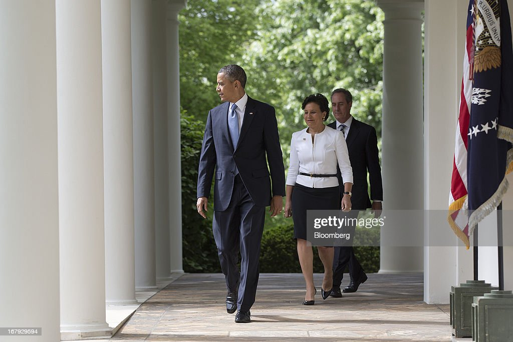 Penny Pritzker, chairman, president and chief executive officer of Pritzker Realty Group LLC and Obama's nominee as secretary of commerce, center, and Michael Froman, deputy national security adviser for international economics and Obama's nominee as U.S. trade representative, right, walk out of the Oval Office with U.S. President <a gi-track='captionPersonalityLinkClicked' href=/galleries/search?phrase=Barack+Obama&family=editorial&specificpeople=203260 ng-click='$event.stopPropagation()'>Barack Obama</a>, left, before making the announcement in the Rose Garden of the White House in Washington, D.C., U.S., on Thursday, May 2, 2013. In nominating Pritzker, the Chicago billionaire and Hyatt Hotels Corp. heiress, Obama is choosing someone who potentially will face aggressive questioning from Republicans during confirmation hearings because of her complex financial portfolio. Photographer: Andrew Harrer/Bloomberg via Getty Images