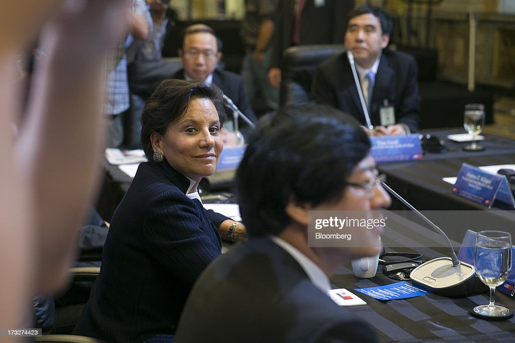 <a gi-track='captionPersonalityLinkClicked' href=/galleries/search?phrase=Penny+Pritzker&family=editorial&specificpeople=5616259 ng-click='$event.stopPropagation()'>Penny Pritzker</a>, secretary of commerce, left, and Tian Guoli, chairman of the Bank of China Ltd., top right, attend a chief executive officer roundtable with U.S. and Chinese business leaders during the U.S.-China Strategic and Economic Dialogue (S&ED) conference at the Treasury Department in Washington, D.C., U.S., on Thursday, July 11, 2013. The U.S. and China are meeting this week to find ways to balance a wider flow of investment and goods as their central banks try to prevent excessive risk-taking from derailing the world's biggest economies. Photographer: Andrew Harrer/Bloomberg via Getty Images