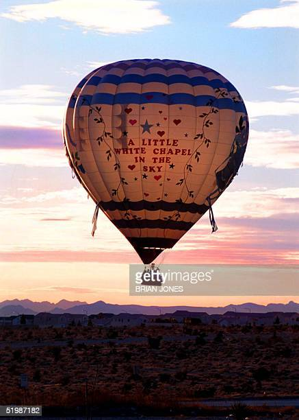 Penny Saylor and Ryan Fender from Dallas Texas fly in a hot air balloon while in Las Vegas on Valentine's Day 14 Februyary 2002 to exchange wedding...