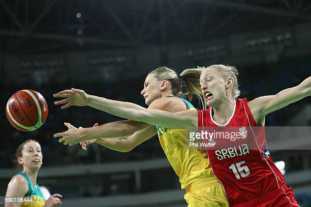 Penny Taylor of Australia and Danielle Page of Serbia contest the ball during the Women's Quarterfinal match between Australia and Serbia at the...