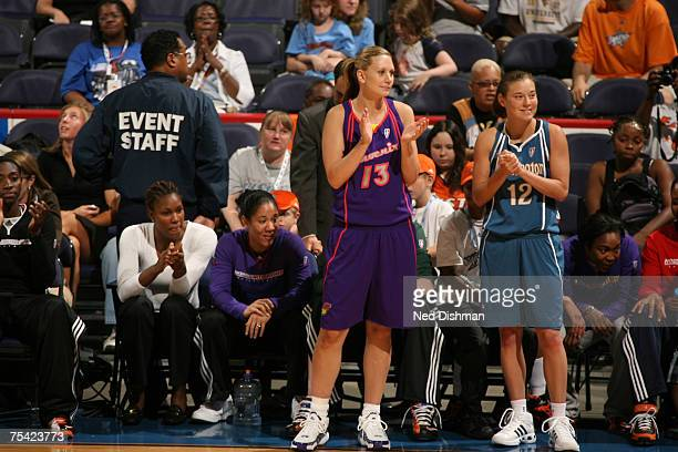 Penny Taylor of the Phoenix Mercury and Laurie Koehn of the Washington Mystics cheer during the 3 Point Shootout prior to the 2007 WNBA AllStar Game...