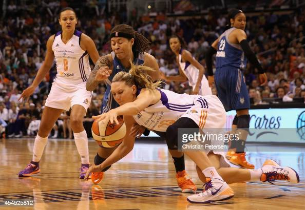 Penny Taylor of the Phoenix Mercury dives for a loose ball with Seimone Augustus of the Minnesota Lynx during game three of the WNBA Western...