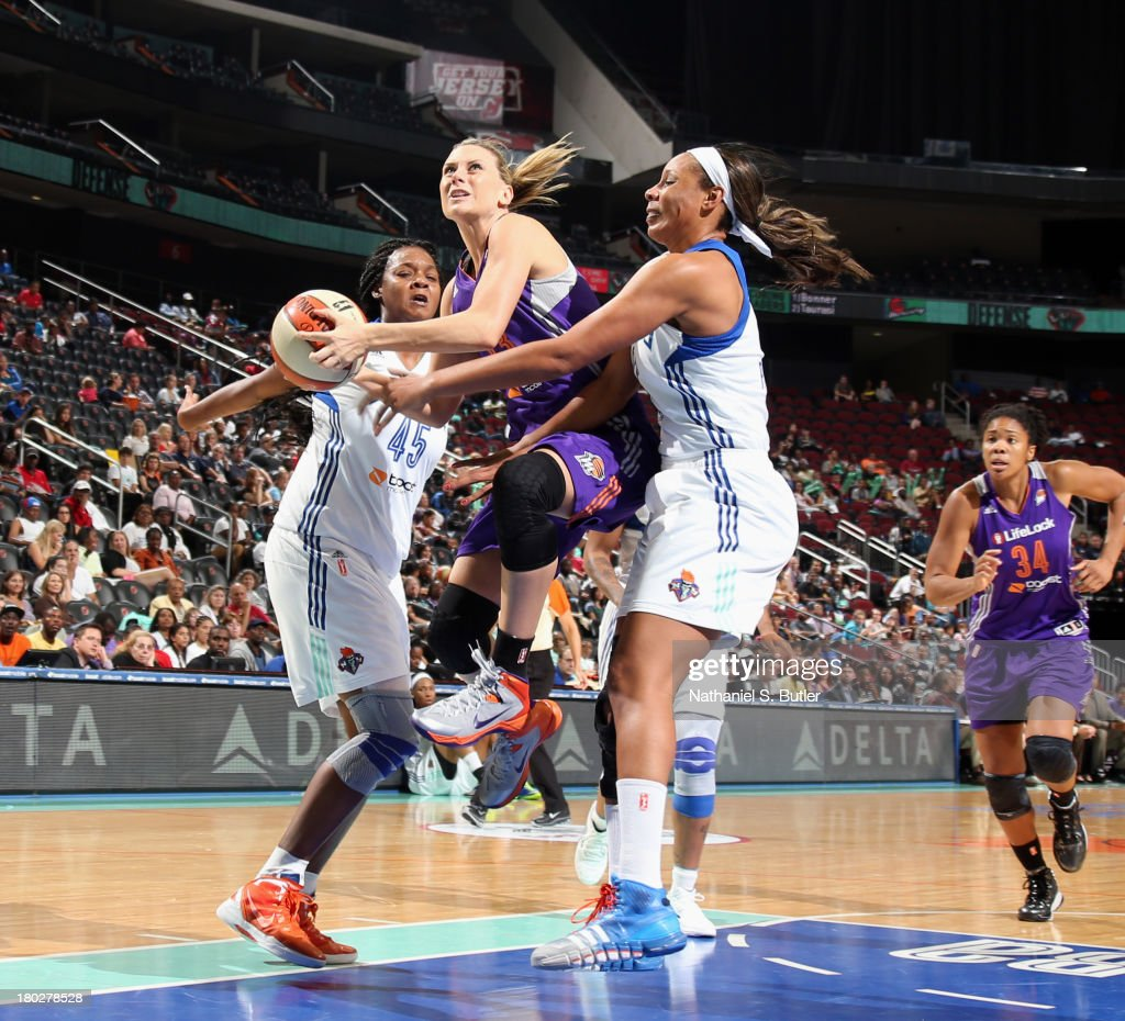 Penny Taylor #13 of the Phoenix Mercury drives against Kara Braxton #45 of the New York Liberty during a game on September 10, 2013 at the Prudential Center in Newark, New Jersey.