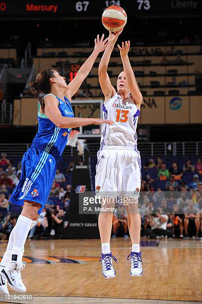 Penny Taylor of the Phoenix Mercury shoots against Nicole Powell of the New York Liberty on August 23 2011 at US Airways Center in Phoenix Arizona...