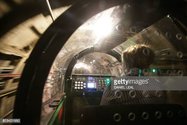 01 GMT / Penny Veck visitors experience manager drives a battery power train inside the Mail Rail tunnels during a media preview of the new Postal...