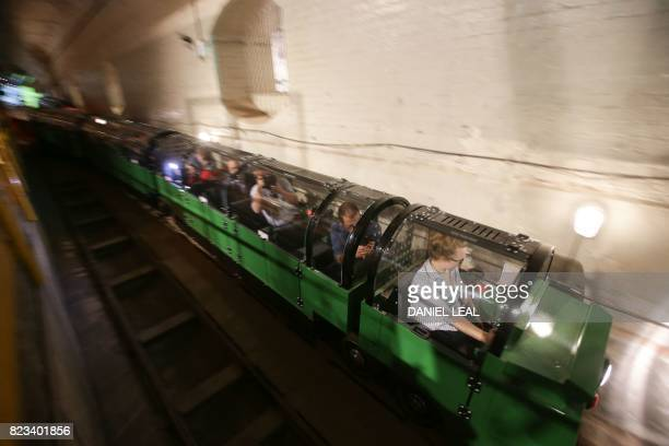 01 GMT / Penny Veck visitors experience manager drives a battery power train carrying members of the press inside the Mail Rail tunnels during a...