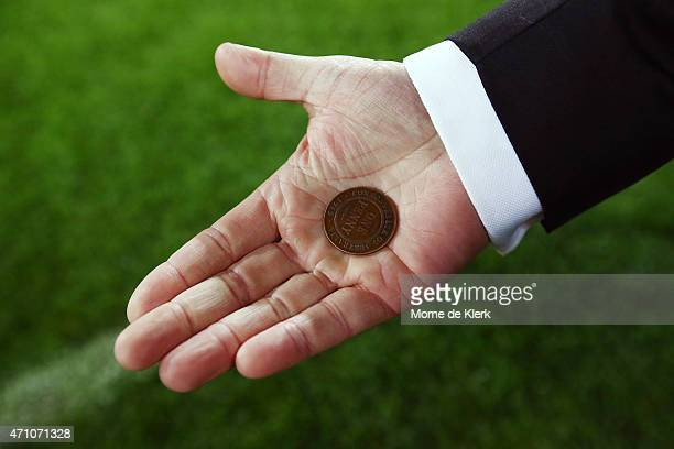 A penny was used for the coin toss on ANZAC Day before the round four AFL match between the Port Adelaide Power and the Hawthorn Hawks at Adelaide...