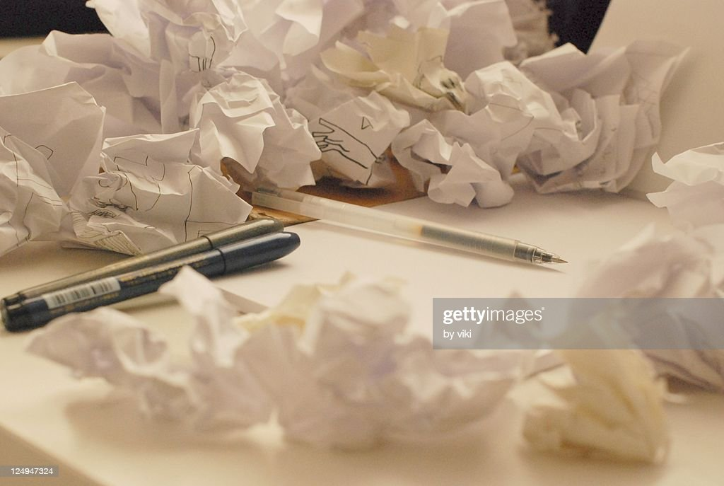 Pens and crumpled paper