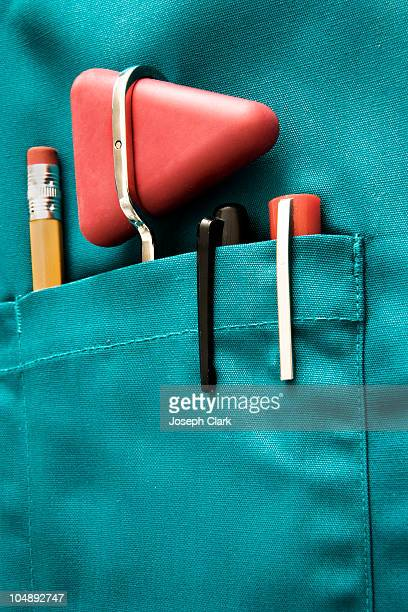 Pens and Reflex Hammer in Doctor's Pocket