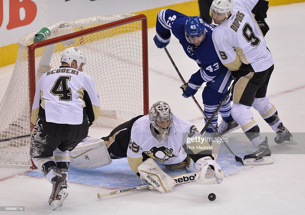 TORONTO - OCTOBER 26 - Pens net minder Marc-Andre Fleury scrambles for a loose puck in 1st period action. Toronto Maple Leafs take on Pittsburgh Penguins on October 26, 2013, at Air Canada Centre during NHL regular season action.