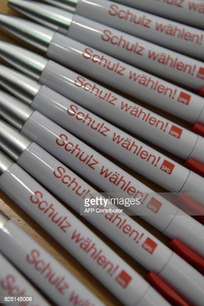Pens reading 'Vote Schulz' refering to SPD chairman and candidate for chancellery Martin Schulz are displayed on August 1 2017 at the Social...