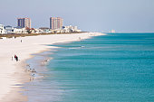Taken this picture of Pensacola beach in Florida in Winter. It was sunny and cold with wind chill around minus 10 degree Celsius. Tried to capture the blue water of gulf of Mexico and deserted beach.
