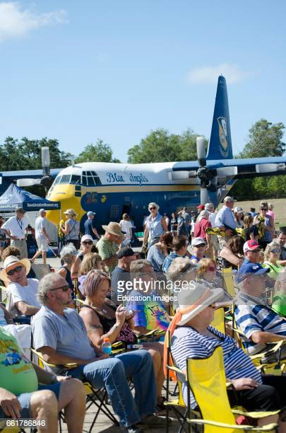 Pensacola Florida USA Visitors to the National Naval Aviation Museum in Pensacola seated by Fat Albert formerly a support plane for the Blue Angels
