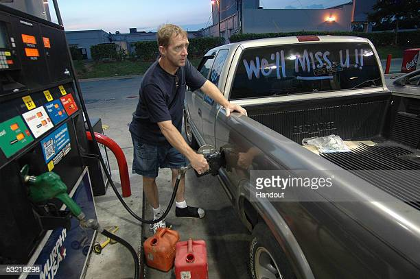 Pensacola resident finds an open gas station at 5AM July 9 2005 in Pensacola Florida Most stations are closed or running low on fuel due to mass...