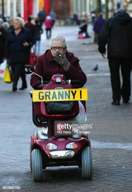 Pensioner Barbara Thompson riding her mobility scooter with a granny plate in South Derbyshire