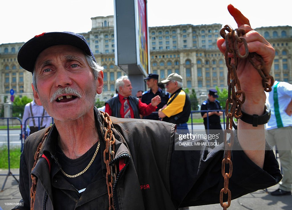A pensioner gestures in front of the parliament on May 25, 2010 during a protest in Bucharest organized by associations of pensioners from the eastern city of Galati. Some 50 pensioners protested against planned cuts -- 25 percent of wages and 15 percent of pensions -- following cost-cutting measures proposed by the government as part of commitments under a 20 billion euro IMF-led rescue package.