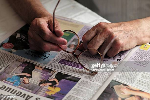 A pensioner reads a newspaper on September 8 2014 in Walsall England Britain is facing multiple problems stemming from an increase in the elderly...