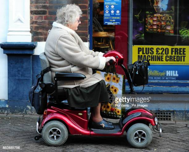 A pensioner riding her mobility scooter near a betting shop in South Derbyshire