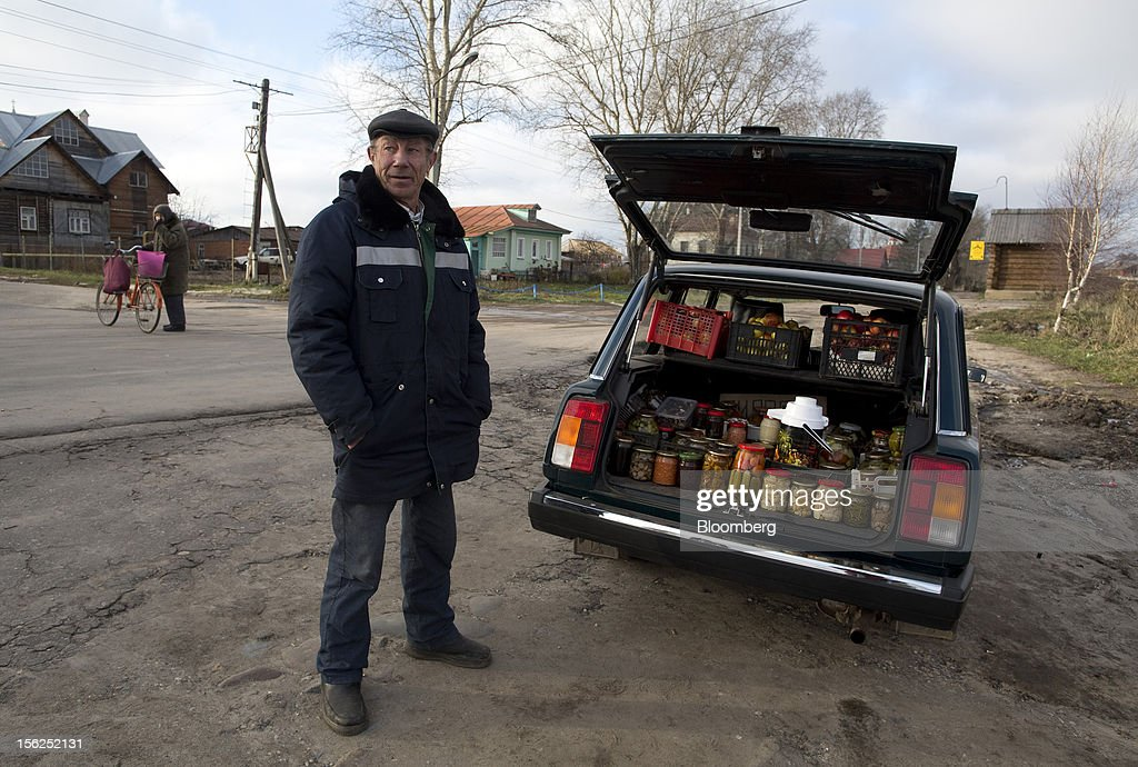 A pensioner sells jars of pickles from the trunk of his vehicle on a roadside in Suzdal, Russia, on Sunday, Nov. 11, 2012. Russia has one of the world's lowest retirement ages, set in 1932 during the Stalin era. Photographer: Andrey Rudakov/Bloomberg via Getty Images