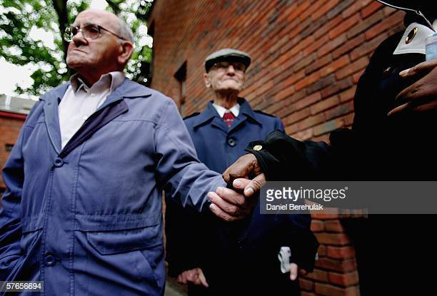Pensioners are assisted outside of a day care centre in central London whilst waiting for a care bus to take them home on May 19 2006 in London...