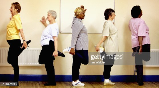 Pensioners Keep Fit As They Participate In An Exercise Class : Stock Photo