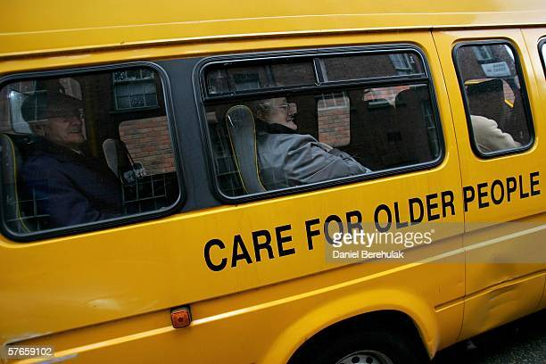 Pensioners look out of the window of the care bus taking them home after attending a day care centre in central London on May 19 2006 in London...