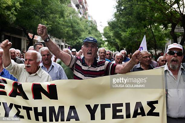 Pensioners march towards the Ministry of Health in Athens during a 24hour strike by health workers and doctors on May 20 2015 Health sector workers...