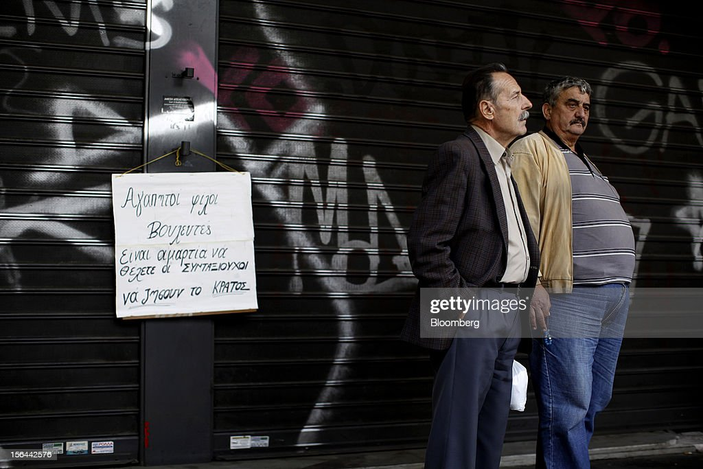 Pensioners protest against pension cuts outside the shuttered entrance to the Labor ministry in Athens, Greece, on Thursday, Nov. 15, 2012. Greece's Supreme Court of Audit ruled that Greek austerity measures including cuts to pensions and an increase in the retirement age may be unconstitutional, state-run Athens News Agency reports, without citing anyone. Photographer: Kostas Tsironis/Bloomberg via Getty Images