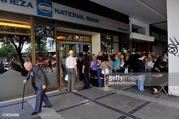 Pensioners queue outside a national bank branch to get their pensions with a limit of 120 euros in Thessaloniki on 3 July 2015 Greece is almost...