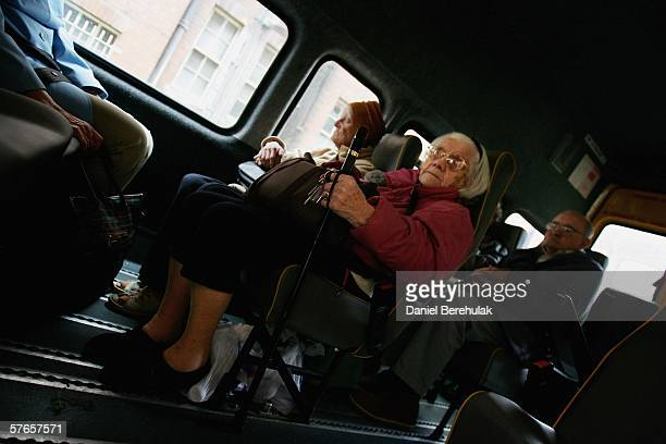 Pensioners sit inside of a care bus taking them home after attending a day care centre in central London on May 19 2006 in London England A deal on...