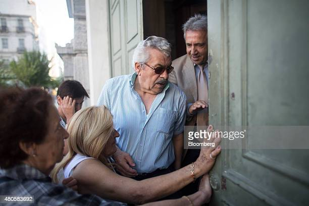 Pensioners struggle to enter a Bank of Greece SA bank branch to collect their pensions in Athens Greece on Monday July 13 2015 Greece has been in...