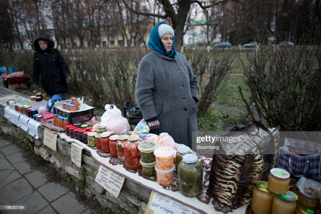 Pensioners wait for customers at their market stalls selling pickles and other home produce in Suzdal, Russia, on Saturday, Nov. 10, 2012. Russia has one of the world's lowest retirement ages, set in 1932 during the Stalin era. Photographer: Andrey Rudakov/Bloomberg via Getty Images