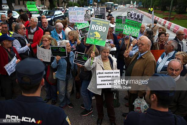 16 Pensioners who lost money investing in preferential shares of rescued bank Bankia briefly block traffic near Madrid's High Court where Rodrigo...
